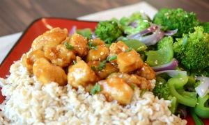 orange chicken chinease resturant food with stir fry vegetables and brown rice2